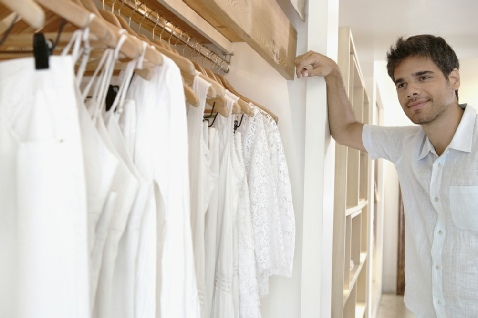White cotton clothes hanging in closet